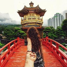 """Murad Osmann's instagram """"Follow Me"""" project. Photos of his world travels with his girlfriend leading him by the hand."""