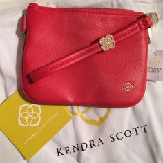 "Kendra Scott wristlet. Price firm. Kendra Scott Wristlet.  Faux leather Detachable wristlet strap Nylon interior lining with one slit pocket Top zip closure Measurements: Body length 7"", height 5¼"", width ¾"", drop handle 5½"" Includes Kendra Scott dust bag. Kendra Scott Bags Clutches & Wristlets"