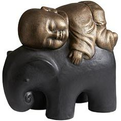 little buddha monk sleepin on lil elephant. Saw this in the store today and it is sooo cute...