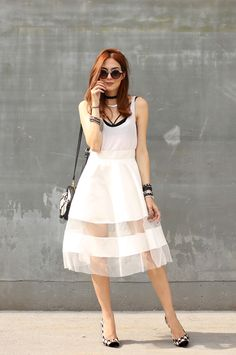 white midi skirt and pied de poule shoes.