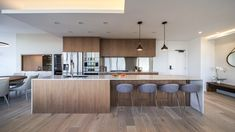 Open plan kitchen and dining area of a multi-generational home with wood accents and contemporary hanging pendant lights Diy Kitchen Decor, Kitchen Interior, Kitchen Ideas, Open Plan Kitchen, New Kitchen, Kitchen Wood, Vancouver, Open Plan Apartment, Modern Kitchen Design