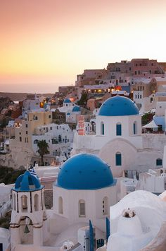 The characteristic blue-domed white houses of Oia on the island of Santorini in Greece at sunset. Sisterhood of the traveling pants was filmed on this Island! You can take a ferry hours) here for about 50 euro from Athens! There are also flights and fas Oh The Places You'll Go, Places To Travel, Places To Visit, Travel Destinations, Greece Destinations, Dream Vacations, Vacation Spots, Italy Vacation, Oia Santorini