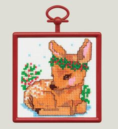 "Christmas Fawn 2.89"". Counted Cross Stitch Mini Kit contains 18-count Aida Fabric, 6-ply cotton floss, needle, chart, frame and easy-to-follow instructions."