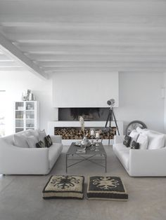 white living space + grey floor pillows