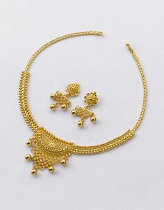 Necklace weight - 14 gm and price Rs.46,600/- Earring weight - 6 gm and price Rs.20,000/-
