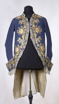 Coat, second half 18th century. Blue silk, richly embroidered with polychrome naturalistic floral motifs.