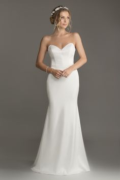 Hallie- Figure hugging wedding dress with sweetheart bodice and mermaid shaped skirt, this style is made in a soft slinky stretch satin