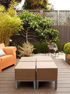 A privacy fence is one of the most common ways to block a view. Here, a simple fence caps off a backyard retreat, providing a perfect, secluded gathering space. A series of container gardens soften the deck, making it even more inviting./