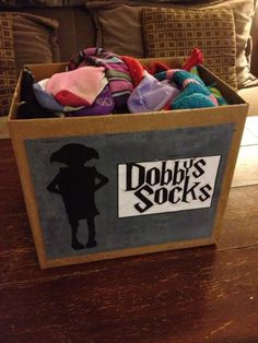 "I forgot where I saw this but it's just a box with your ""Dobby's Socks"" art on the front.  Great idea for the laundry area."