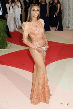 """New York, NY - Beyonce looks absolutely lovely in her pastel latex dress embellished with beads for the 2016 Met Gala held at the Metropolitan Museum of Art. The theme this year is """"Manus x Machina: Fashion in an Age of Technology."""" AKM-GSI          May 2, 2016To License These Photos, Please Contact :Steve Ginsburg(310) 505-8447(323) 423-9397steve@akmgsi.comsales@akmgsi.comorMaria Buda(917) 242-1505mbuda@akmgsi.comginsburgspalyinc@gmail.com"""
