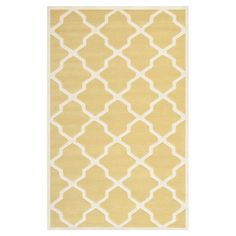 With its trellis design and sunny palette, this wool rug is the perfect complement to the glossy white finishes, glass topped table and neutral decor of your...