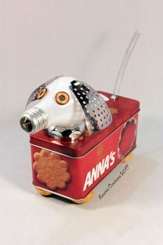 """""""Anna's dog Cookie"""" ~ Found object art created by Laurie Schnurer. The tin opens for storage. To purchase one of Laurie's Creatures click on this link to her sales page. https://www.facebook.com/LauriesCreatures/"""
