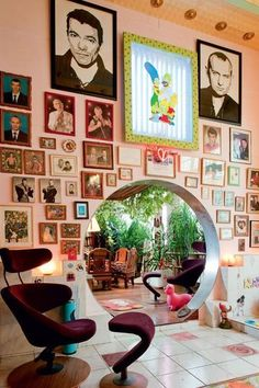 Just love this, decorating insanity that makes me smile! L'appartement intime de Pierre et Gilles. Chinese moon door between the living room & dining room. Cote Maison Paris