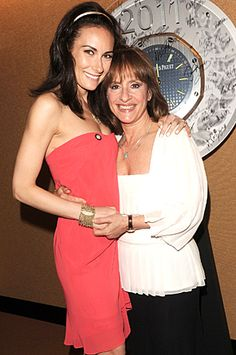 2011 Tony Award-nominees Laura Benanti (left) and Patti LuPone of Women on the Verge of a Nervous Breakdown sign a commemorative clock designed by Swiss watchmaker Audemars Piguet, which will be auctioned to benefit Broadway Cares/Equity Fights AIDS.