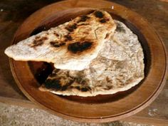 GIRDLE BREAD - Bread was part of the staple diet in Medieval times.This is a simple risen bread which uses ale (the yeast in the ale) to make the bread rise. The ale is warmed to activate the yeast. Many early breads and biscuits were baked on flat metal pans, much as earlier peoples had cooked on bake stones. The heat from the griddle cooks the food. - Medieval Recipe   (cookit.e2bn.org)
