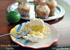 Lime in the Coconut Cupcakes -- Coconut cake, lime curd filling, with whipped frosting.  Yum!