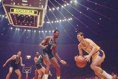 Lakers guard Jerry West drives past Celtics center Bill Russell in Game Boston went on to a win at the Forum to clinch the series
