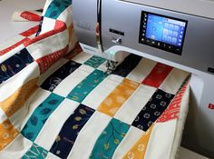 In this week's Quilt Along, you will learn an easy technique to spray baste the layers of your quilt together - along with a few great tips and tricks.