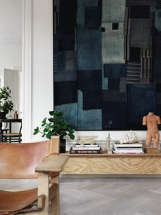 A boro cloth with sashiko stitching in Lotta Agaton's Stockholm living room.  Featured at Remodelista.