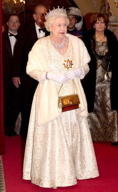 2008 from Queen Elizabeth II's Royal Style Through the Years  The Queen opted for a white brocade dress and fur stole for her appearance at a state banquet in Slovakia.
