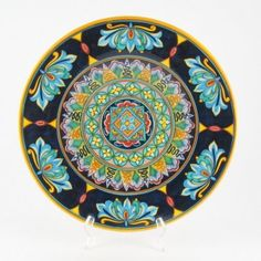<p>In this fine wall plate designs of traditional ceramics of Deruta uniquely blend with more contemporary colors and designs. <br />D&G are two young artists, with a great creative talent and an excellent experience on traditional Italian ceramics. Some of D&G pottery may seem very traditional, but at a closer look it will always reveal a unique touch, be it an unusual color or a different way to interpret a classic pattern.</p>