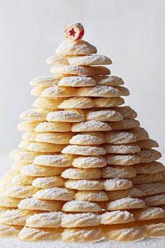 """Stack up these coconut-infused spritz cookies and quickly watch the """"tree"""" disappear. Use a food processor to easily get those coconut flakes finely chopped. #spritzcookies #bestspritzcookies #christmascookies #bhg"""