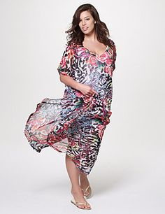 Flaunting a fresh mix of floral and zebra prints and a dramatic loose silhouette, our chiffon swim cover up makes a delightful addition to your fun-in-the-sun style! Quick-drying, lightweight chiffon offers poolside comfort, with draping sides and short sleeves for a flattering fit. Sexy V-neck and leg slits complete the look. Lined to the knee. lanebryant.com