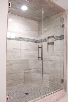 Shower Tile: Anatolia, Amelia: Mist Polished 12x24; Accent Tile: Eclipse Interlocking Mosaic; Shower Floor and Bench: Anatolia, Amelia: Smoke 2x2.