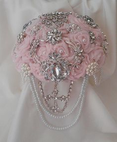 Elegant Christian Cascading Brooch Bouquet by FabulousBouquets, $100.00 Deposit We offer complete bridal packages including, matching bouquets for bridesmaids and maid of honor, boutonnieres, wrist corsages that are perfect for the mothers of the bride and groom, flower girls basket, ring bearer pillows, pins for gifts and much more