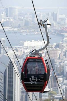 Shin-Kobe Ropeway that travels over the city, a bunch of trees and a waterfall. Downtown Kobe in the background Hyogo, Shiga, Study Japanese, Japanese Style, Kobe Japan, Wakayama, Nara, Japan Travel, Romania