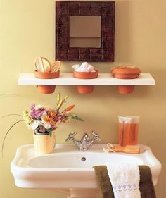 upstairs bathroom make over.... replace flower pots with cute glass for toothbrushes.
