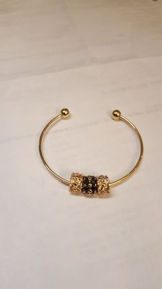 Gold plated Sterling silver cuff bracelet with screw on end beads. CZ and Black onyx beads. by MDEBRJewelryDesigns on Etsy