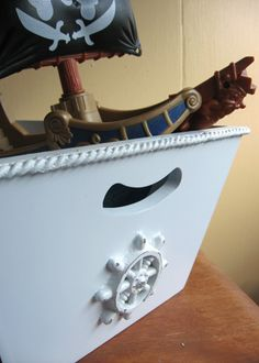 L-O-V-E this toy bin! I was really into the whole nautical theme when I decorated my son's room. Wish I had seen this then. $48