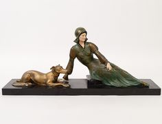 A French Art Deco Painted Bronze and Marble Sculpture, Cipriani.