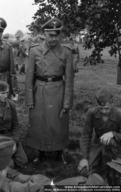 """Reichsführer-SS Heinrich Himmler observes field training during a visit to a forward formation. Himmler had prominent illusions about his capacity as senior combat leader and was constantly on field trips to """"evaluate"""" Waffen SS training. When shortly before the end of the war he was given a high command post, he failed disastrously and was quick in trying to escape capture."""