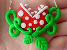 Super Mario Piranha Plant Necklace. The necklace isn't great but I like the framing if the plant. Tattoo maybe. -jo