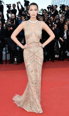 Festival de Cine de Cannes 2016 Acto: Ceremonia de apertura y estreno de la película 'Café Society'. Fecha: 11 de mayo de 2016. En la imagen: La modelo Bella Hadid, de Roberto Cavalli Couture, con un vestido de noche en color maquillaje con escote criss cross y choker, y zapatos de Stuart Weitzman.