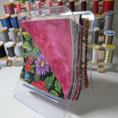 """Clear expandable napkin holders from IKEA are perfect for holding my 5-7"""" squares as well as my turnover cuts. These are amazing and at a cost of $1.99 you can't go wrong!"""
