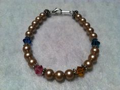 Birthstone Bracelet. Perfect gift for Mother's Day, Birthday, Grandparents Day and Christmas :) You can choose the color pearls your would like. - $10