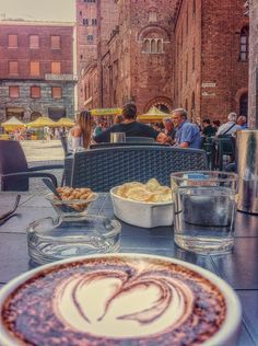Cappuccino with a beautiful view in Cremona, the city of the violin. #Italy #travel