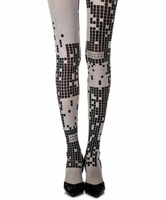 7374fc105212b Spice up your outfits with a pair of these fashionable light grey Patterned  tights by Zohara. Featuring funky black print pattern on both legs,  depending on ...