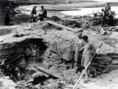 Excavating Skara Brae in the 1920's. Gordon Childe (left) and students.