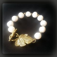 """""""NEO""""  """"NEO""""  These cultured pearls are carefully joined together with links of 14k gold. Pearls are classic and eternal. This will absolutely make the perfect holiday gift for that special lady young or full of wisdom, or simply the perfect gift to yourself because we all deserve a little treat.  The ancient Egyptians prized pearls so much that they were buried with them. Cleopatra reportedly dissolved a pearl from one of her earrings in a glass of either wine or vinegar, depending on the…"""