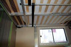 Elektrisches Hubbett im Wohnmobil von unten: Mechanik mit Zentralwelle und…
