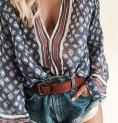 Boho print long sleeve flowy shirt with jean shorts and a wide leather brown belt. Casual outfit street style cut women's clothing girls night out brunch outfit