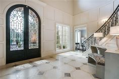 entryway | obsessed with these iron doors
