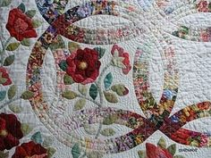 double wedding ring quilt with floral fabrics and floral appliques - Wedding Ring Quilt Pattern