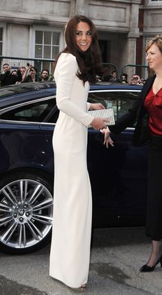 Kate Middleton in a long white sheath dress. Super cute!