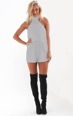 """Stylish, feminine and cut in classic grey, this high neck playsuit features a structured choker piece, frill midsection and a flattering """"two-piece"""" look. Features: - High neckline - Frill detail - Cu"""