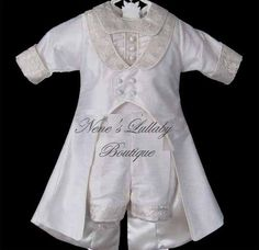 Christopher by Piccolo BAcio, Designer white silk boys christening suit with matching hat available at http://www.neneslullabyboutique.com